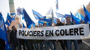 Des policiers lors de la manifestation appelée par le syndicat Alliance de la Police nationale à Paris, le 13 novembre 2014 (WITT / SIPA)