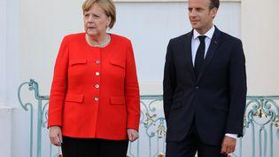 Angela Merkel et Emmanuel Macron lors d'une conférence de presse commune à Meseberg, près de Berlin, en Allemagne, le 19 juin 2018. (LUDOVIC MARIN / AFP)