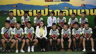 Les enfantsrescapés de la grotte deTham Luang (Thaïlande), en conférence de presse, le 18juillet 2018 à Chiang Rai.  (LILLIAN SUWANRUMPHA / AFP)