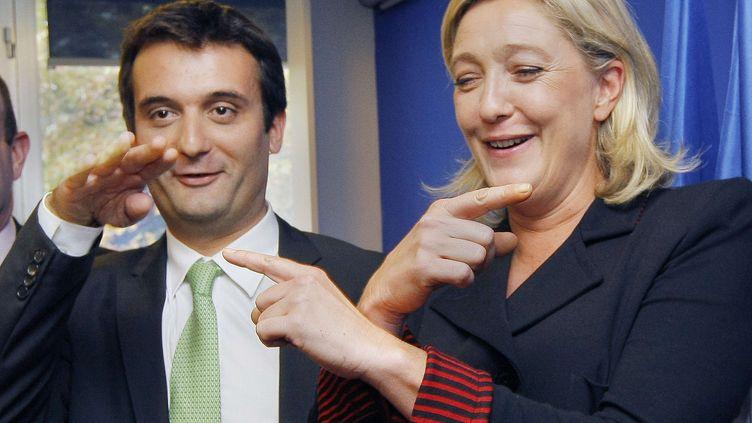 Marine Le Pen, candidate du Front national à la présidentielle, et Florian Philippot, son directeur stratégique de campagne, le 6 octobre 2011 à Nanterre (Hauts-de-Seine). (JACQUES BRINON / AP / SIPA)