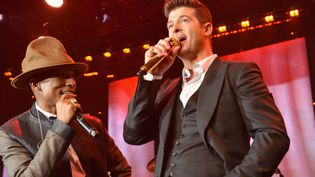 Pharrell Williams et Robin Thicke, le 25 janvier 2014, à Beverly Hills.  (Larry Busacca / GETTY IMAGES NORTH AMERICA / AFP)