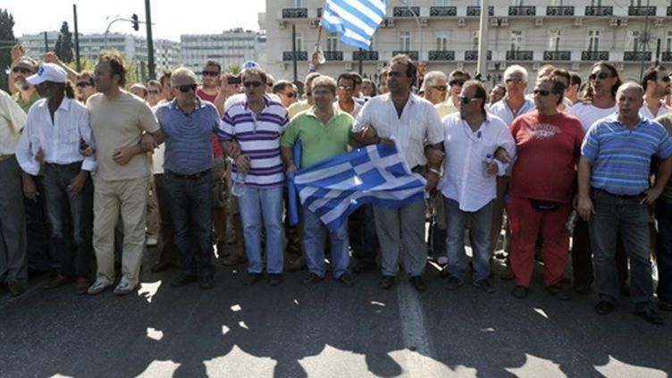 Des chauffeurs routiers grecs manifestent devant leur Parlement le 30 juillet (AFP Louisa Gouliamaki)