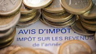 La réduction de l'impôt sur le revenu touchera 7 millions de foyers fiscaux en 2016, révèle France 2, vendredi 4 septembre 2015. (JOEL SAGET / AFP)
