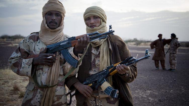 Des rebelles touareg du Mouvement national de libération de l'Azawad, en 2011. (FERHAT BOUDA / MAXPPP)