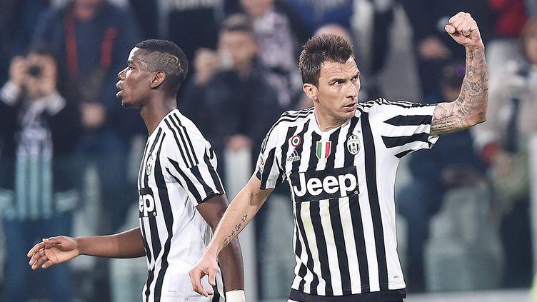 Paul Pogba et Mario Mandzukic, les deux buteurs de la Juventus contre le Milan AC (DI MARCO / ANSA)