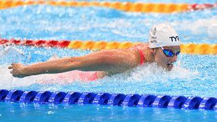 Marie Wattelen finale du 100 mètres papillonaux Jeux olympiques de Tokyo, le 25 juillet 2021. (MUSTAFA YALCIN / AFP)