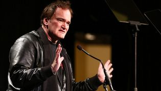Quentin Tarantino sur scène lors des 33e Variety Home Entertainment Hall of Fame, en décembre 2013, à Los Angeles  (Imeh Akpanudosen / GETTY IMAGES NORTH AMERICA / AFP)