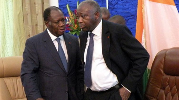 Alassane Ouattara et Laurent Gbagbo (à droite). (AFP - Ahmed Ouoba)