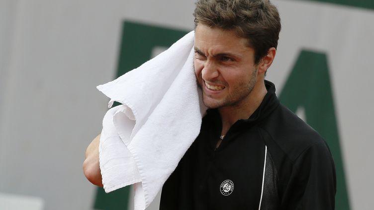 Gilles Simon s'arrête en huitième de finale de Roland-Garros. (PATRICK KOVARIK / AFP)