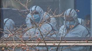 Deséquipesdel'OMS enquêtent sur les origines du Covid-19 à Wuhan, en Chine, le 2 février 2021. (HECTOR RETAMAL / AFP)