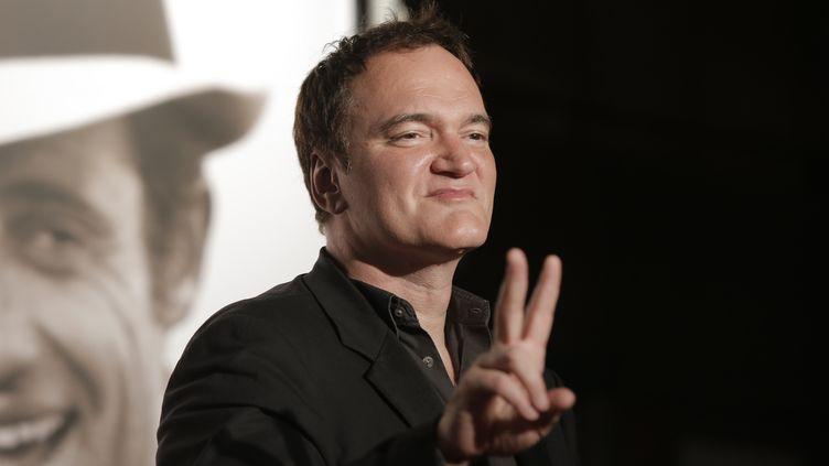 Le réalisateur Quentin Tarantino pose pour les journalistes lors d'un festival à Lyon, le 14 octobre 2013. (LAURENT CIPRIANI / AFP)