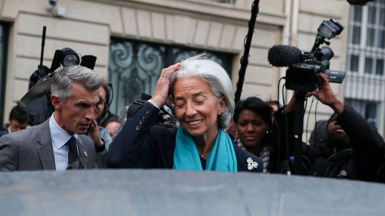 (Christine Lagarde sortant de la CJR en 2013, après une douzaine d'heures d'audition. © Maxppp)