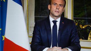 Emmanuel Macron lors d'une allocution au lendemain de l'incendie de Notre-Dame de Paris, le 16 avril 2019 à l'Elysée. (OLIVIER MORIN / AFP)