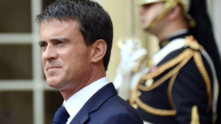 Le Premier ministre Manuel Valls sur le perron de Matignon, à Paris, le 2 septembre 2014. (BERTRAND GUAY / AFP)