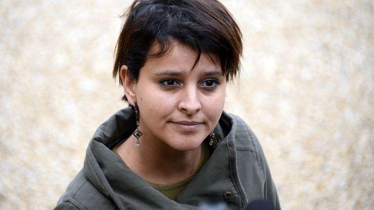 La porte-parole du gouvernement, Najat Vallaud-Belkacem, le 3 janvier 2014 dans la cour de l'Elysée à Paris, à l'issue du premier Conseil des ministres de l'année. (BERTRAND GUAY / AFP)