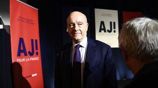Alain Juppé au siège de sa campagne, à Paris, après le premier tour de la primaire à droite, le 20 novembre 2016. (MARTIN BUREAU / AFP)