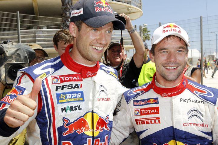 30 mai 2010, Portugal. Sébastien Ogier, ici aux côtés de Sébastien Loeb (2e), après sa première victoire en WRC. (FRANCOIS BAUDIN / AUSTRAL)