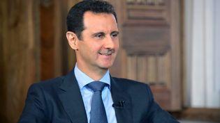 Bachar Al-Assad, le 26 août 2015 à Damas (Syrie). (SANA / AFP)