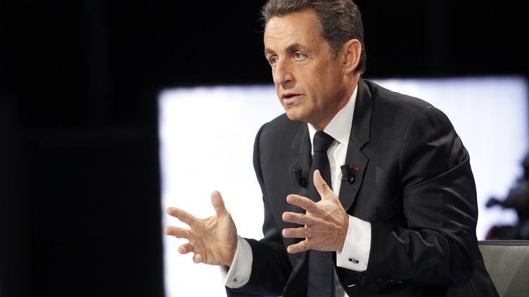 """Nicolas Sarkozy, le 12 avril 2012, sur le plateau de """"Des Paroles et des Actes"""", sur France 2. (THOMAS SAMSON / POOL / AFP)"""