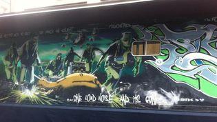 """La fresque de Banksy """"Silent Majority"""" exposée devant Drouot le 1er juin 2015.  (Laure Narlian/Culturebox)"""