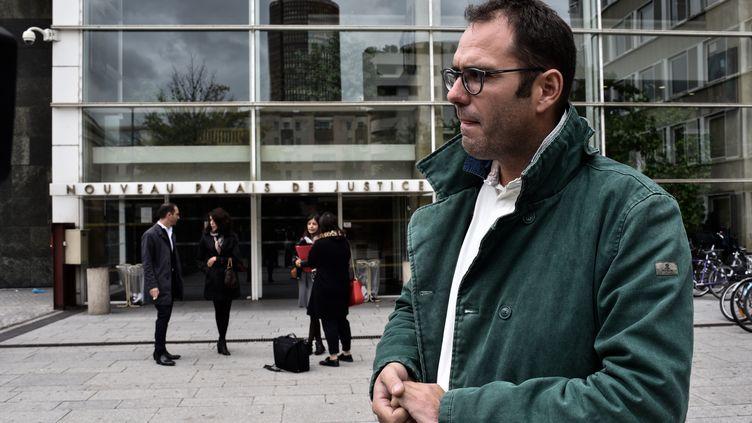 Francois Devaux, le président de l'association La parole libérée, devant le palais de justice Lyon, le 19 septembre 2017. (JEFF PACHOUD / AFP)