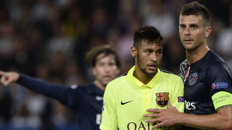 Neymar (Barça) et Thiago Motta (PSG) (FRANCK FIFE / AFP)