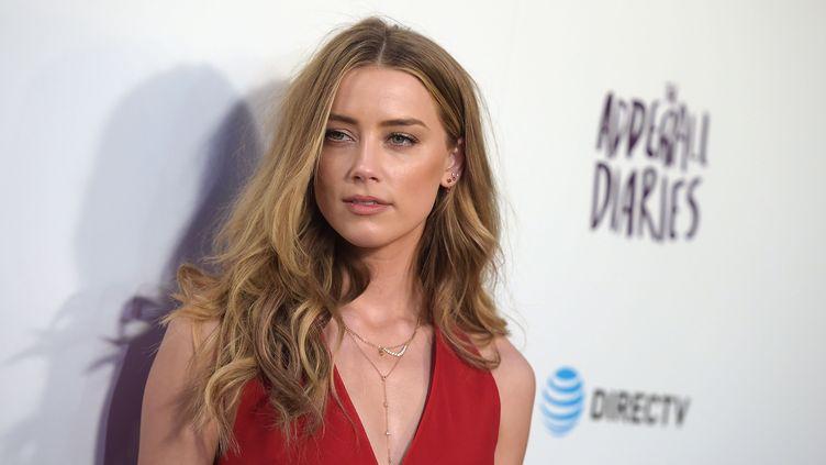 """L'actrice Amber Heard àl'avant-première de """"The Adderall Diaries"""" à Hollywood, en Californie (Etats-Unis), le 12 avril 2016. (JASON KEMPIN / GETTY IMAGES NORTH AMERICA / AFP)"""