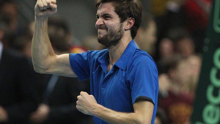 Gilles Simon après sa victoire contre l'AllemandJan-Lennard Struff, le 6 mars 2015 à Francfort en Allemagne. (DANIEL ROLAND / AFP)