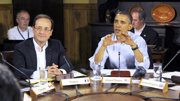 François Hollande et son homologue américain Barack Obama, lors d'une réunion de travail du sommet du G8, le 19 mai 2012 à Camp David (Etats-Unis). (PHILIPPE WOJAZER / AFP)