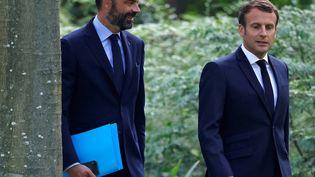 Édouard Philippe (G) et Emmanuel Macron (D), le 29 juin 2020. (CHRISTIAN HARTMANN / POOL / AFP)