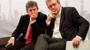 Le coprésident du Parti de gauche, Jean-Luc Mélenchon, et le secrétaire national du Parti communiste, Pierre Laurent, lors d'une conférence de presse à Besançon (Doubs), le 24 janvier 2012. (REVELLI-BEAUMONT / SIPA)
