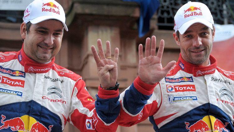 Sébastien Loeb et Daniel Elena (Citroën) célèbrent leur neuvième sacre consécutif en Championnat du monde WRC, le 7 octobre 2012. (FREDERICK FLORIN / AFP)