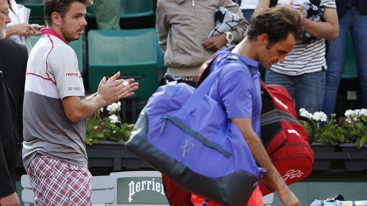 Roger Federer battu par Stanislas Wawrinka à Roland-Garros le 2 Juin 2015. (KENZO TRIBOUILLARD / AFP)