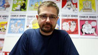 """Le caricaturiste Charb, ancien directeur de """"Charlie Hebdo"""" en 2012  (FRANCOIS GUILLOT / AFP)"""