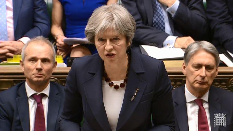 Theresa May s'exprime devant le Parlement britannique, à Londres le 14 mars 2018. (HO / PRU / AFP)