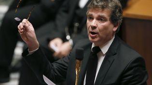 Le ministre du Redressement productif,Arnaud Montebourg, le 7 janvier 2014 à l'Assemblée nationale. (PATRICK KOVARIK / AFP)