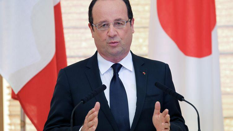 François Hollande, le 7 juin 2013 à Tokyo (Japon), lors d'une conférence de presse. (JUNKO KIMURA / AFP)