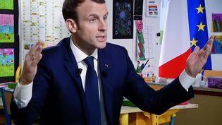 Le président Emmanuel Macron lors de son interview pour le 13 heures de TF1, délocalisé dans une école de l'Orne, le 12 avril 2018. (MAXPPP)