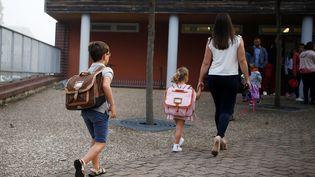 L'école devient obligatoire dès 3 ans à partir du 1er septembre 2019. (Photo d'illustration) (CHARLY TRIBALLEAU / AFP)