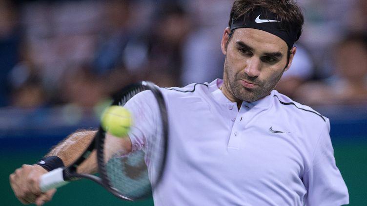 Roger Federer (NICOLAS ASFOURI / AFP)