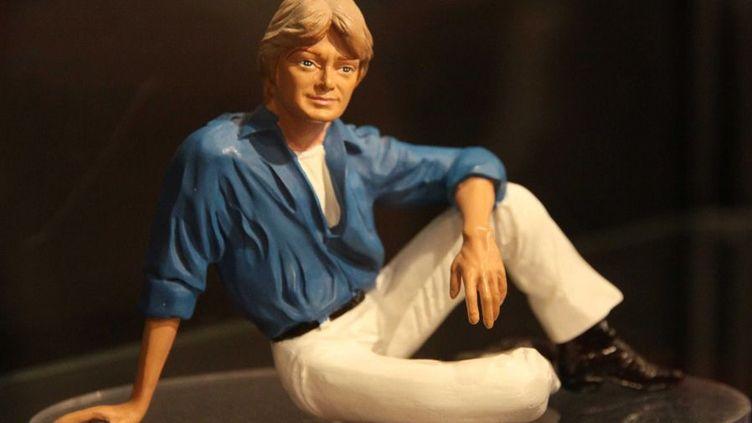 Cette figurine fait partie des objets évoquant Claude François, vendus aux enchères le 25 mai à Paris  (PMG/SIPA)
