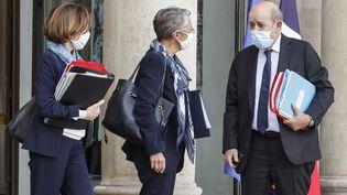 Florence Parly, Elisabeth Borne et Jean-Yves LeDrian àl'Elysée, le 21octobre 2020. (LUDOVIC MARIN / AFP)