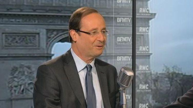 François Hollande, le 14 février 2012 au micro de BFM-TV. (FTVI / BFM-TV)