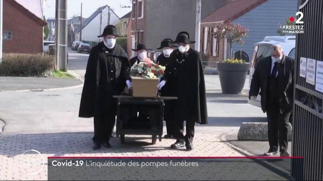 Coronavirus: les pompes funèbres surchargées dans les foyers