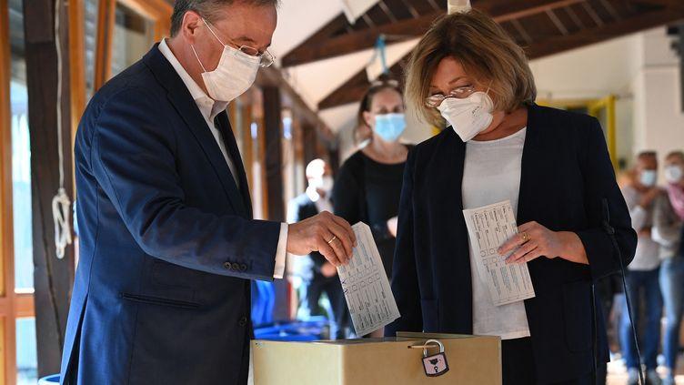 Le candidat de la CDU, Amin Laschet, vote à Aix-la-Chapelle, en Allemagne, lors des élections législatives, dimanche 26 septembre 2021. (AFP)