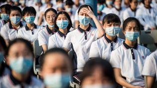 Des étudiants chinois lors d'une cérémonie le 1er septembre 2020. (STR / AFP)