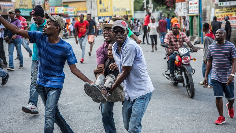 Des émeutes éclatent à Port-au-Prince (Haïti), le 18 novembre 2019. (VALERIE BAERISWYL / AFP)
