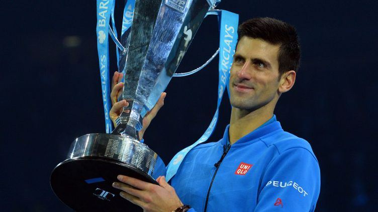 Novak Djokovic a conclu de la plus belle des manières une saison 2015 exceptionnelle en remportant le cinquième Masters de sa carrière. (GLYN KIRK / AFP)