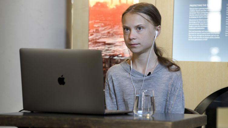 Greta Thunberg, le 22 avril 2020, lors d'une visioconférence à laquelle elle participe depuisStockholm, en Suède. (JESSICA GOW / TT NEWS AGENCY / AFP)