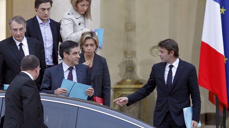 François Fillon, François Baroin et Valérie Pécresse à la sortie d'une réunion à l'Elysée consacrée au second plan d'austérité, samedi 5 novembre 2011. (FRANCOIS GUILLOT/AFP)